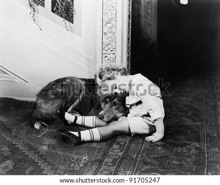 little boy and his dog sleeping