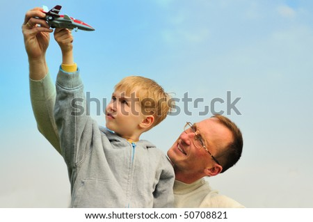 Little boy and his father are playing outdoor
