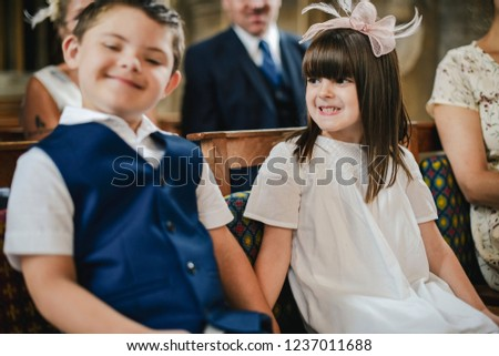 Little boy and little girl holding hands