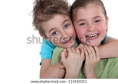 Little boy and little girl hugging - stock photo
