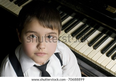 Little boy and piano.