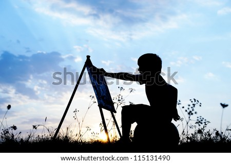 Little boy artist drawing and painting in nature