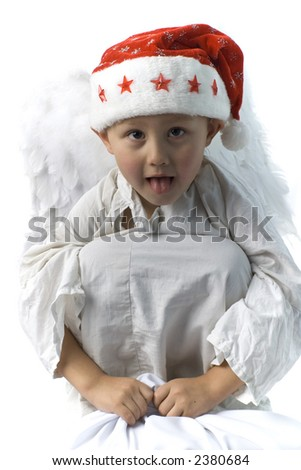 little boy as angel in red xmas hat