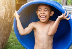 Little boy asia good mood playing water bathing in a basin