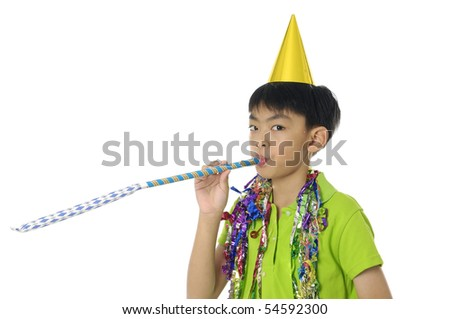 Little boy blowing a Party Favor and Wearing a Party Hat