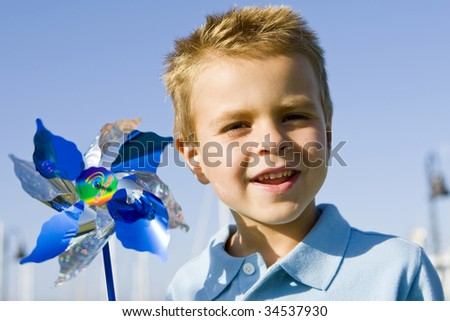Little boy blowing on a pinwheel
