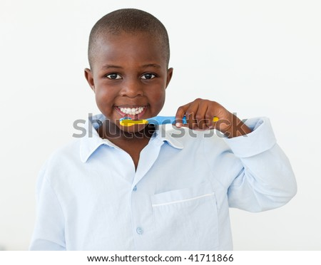 Little boy brushing his teeth in the bathroom
