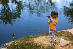 Little Boy Catching a Fish