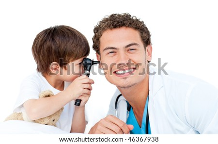 Little boy checking doctor's ears against a white background
