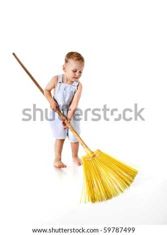 Little boy cleaning with broom