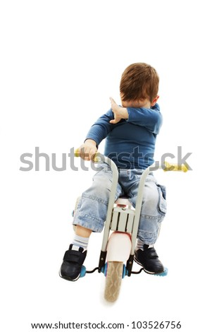 Little boy crying on bike. Isolated on white background.