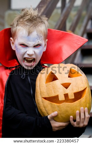 little boy curve faces in fairy costume on holiday halloween