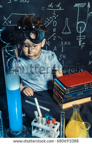 Little boy doing experiments in the laboratory. Explosion in the laboratory. Science and education.