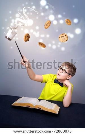Little boy doing magic