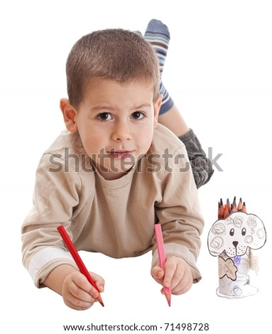 Little boy drawing with two pencils