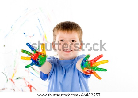 little boy draws bright colors