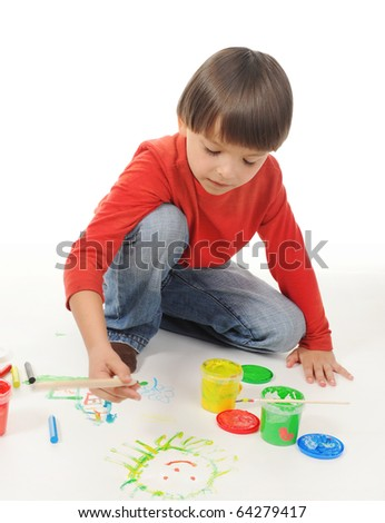 little boy draws paint. Isolated on white background