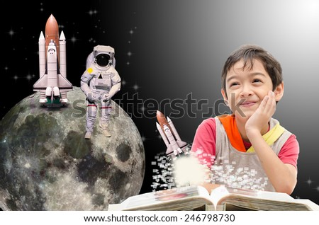 Little boy dreaming  about his future out of space to the moon - \