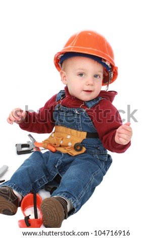 Little boy dressed as a construction worker