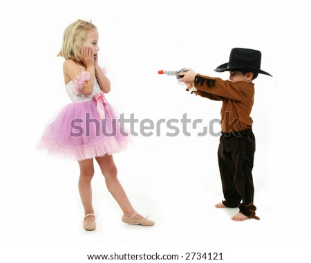 Little boy dressed as a deputy and girl in ballerina costume role ...