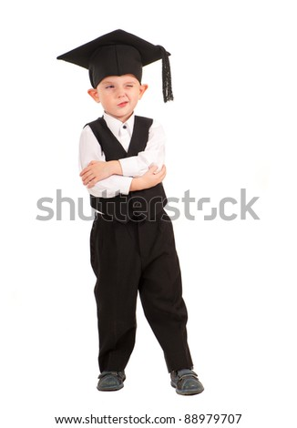 Little boy dressed Bachelor cap isolated over white