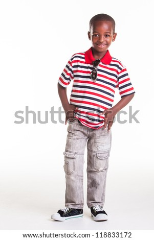 Little boy dressed in stripes and denim for a photographic shoot in the studio.