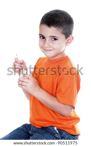 little boy eating yogurt on white background