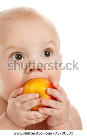 little boy eats an apple