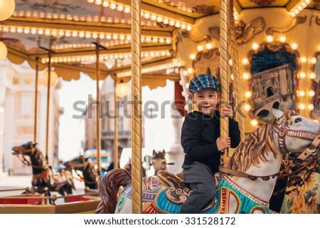 little boy enjoying his ride at ...
