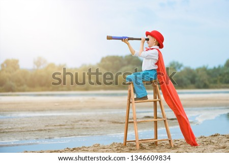 little boy explorer  with a telescope on a ladder, outdoor,side view,  #1346609834
