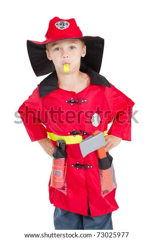 little boy firefighter blowing his whistle