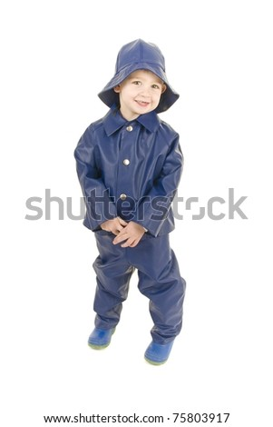 Little Boy fisherman is ready for rainy weather