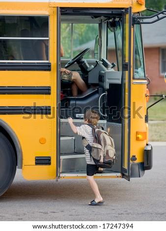 Little Boy Getting on Bus