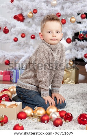 little boy getting ready for the holiday. Happy New Year and Merry Christmas!
