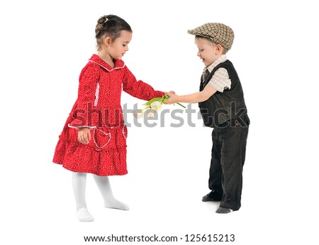 Little boy gives flowers to the little girl
