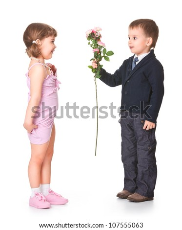 little boy gives girlfriend flowers, behind a white background