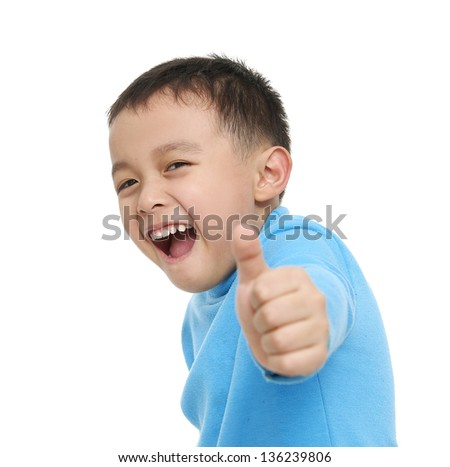 little boy giving you thumbs up �close up