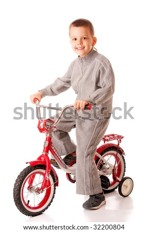 Little boy goes on bike, is isolated on white background.
