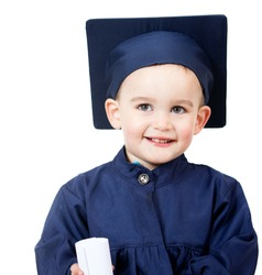 Little boy graduating in a blue gown - isolated over white