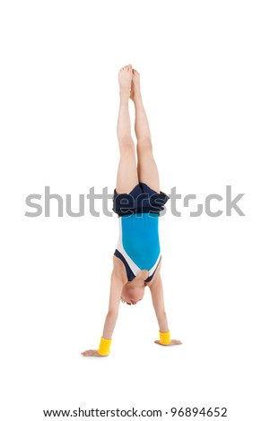 little boy gymnast standing head over feet - stock photo