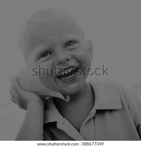 Little boy having fun on a beach Laughing Concept #388677349