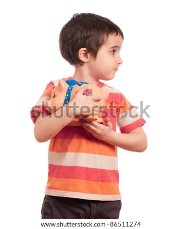 Little boy hides his piggy bank isolated on white
