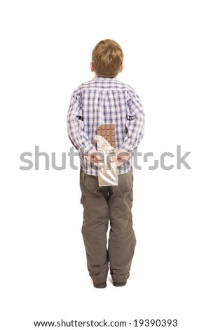 Little boy, hiding a large chocolate bar (isolated on white)