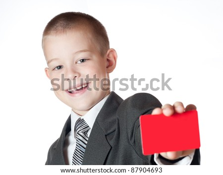 little boy holding a blank. Isolated on white background