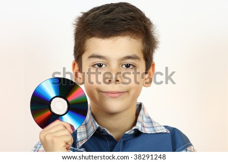Little boy holding a CD in hand