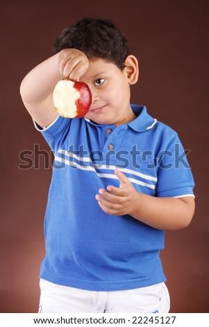 Little boy holding an apple