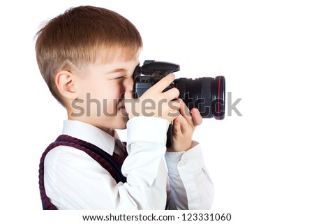 Little Boy holding camera and taking photo. isolated