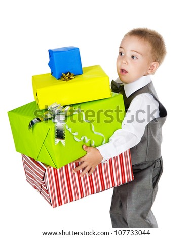 little boy holding many gifts in arms. isolated on white background