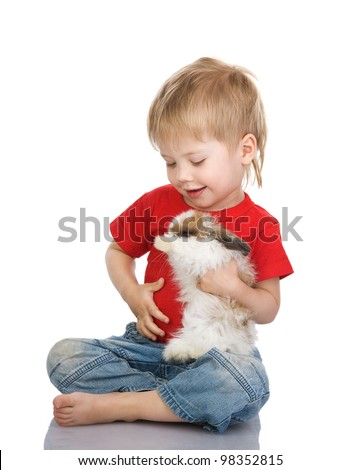 Little boy holding the small rabbit. isolated on white background