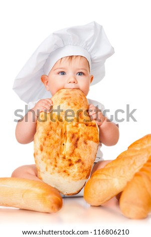 Little boy in a cap and with bread